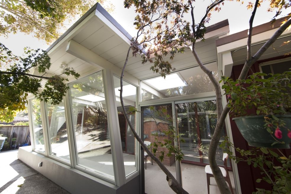 Modern glass extension makes the connection with nature