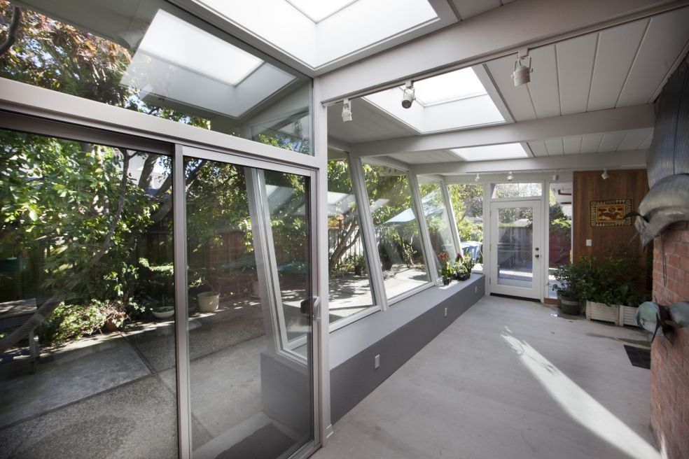 Keycon glass porch transforms both the house and the yard