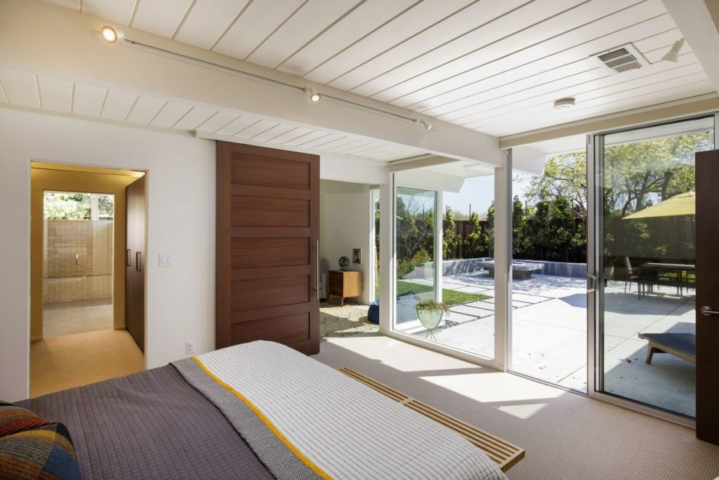 Ultra-efficient modern bedroom leads to storage and bath