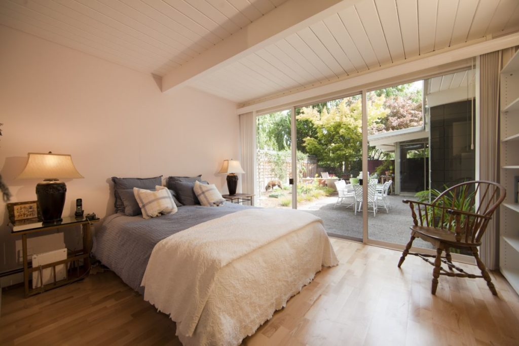 Wake up to the light with a bedroom patio by Keycon