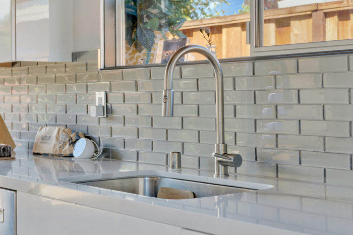 Sleek and functional modern kitchen fixtures for this Keycon Eichler