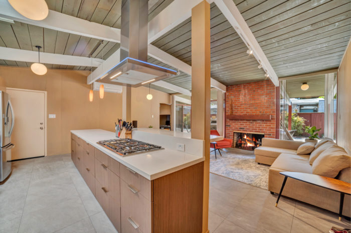 Keep everyone warm by the fire in this storybook Eichler remodeled by Keycon