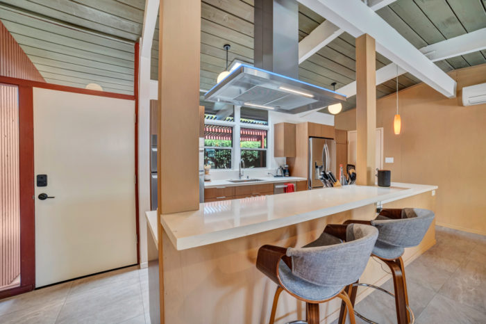 The kitchen is the focal point for this Keycon-remodeled Palo Alto Eichler