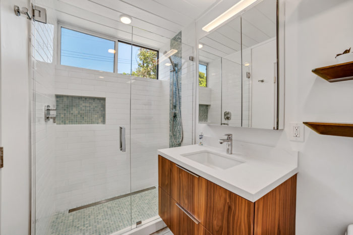 Stylish and functional modern Eichler bath with tile, glass, and wood finishes remodeled by Keycon