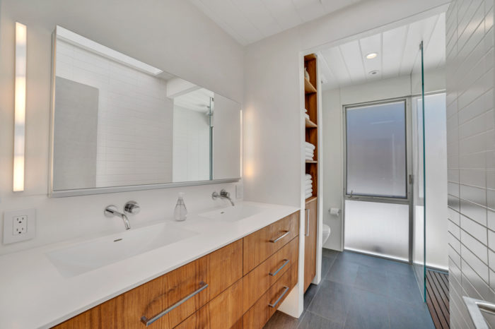 The opposite long view of this restful bath space remodeled by Keycon with modern amenities and natural finishes