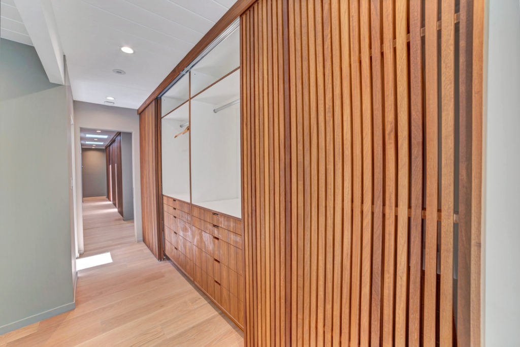 Look inside the storage. Ample space behind the sliding doors in this Keycon-remodeled Eichler