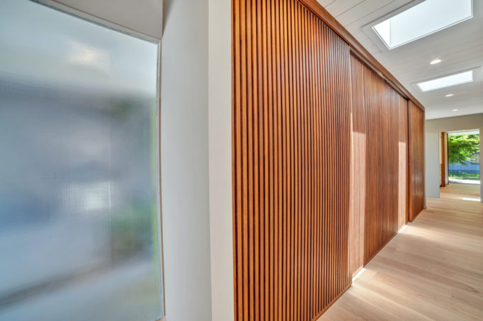Natural light streams from the ceiling and the walls in this Keycon-remodeled San Mateo Eichler