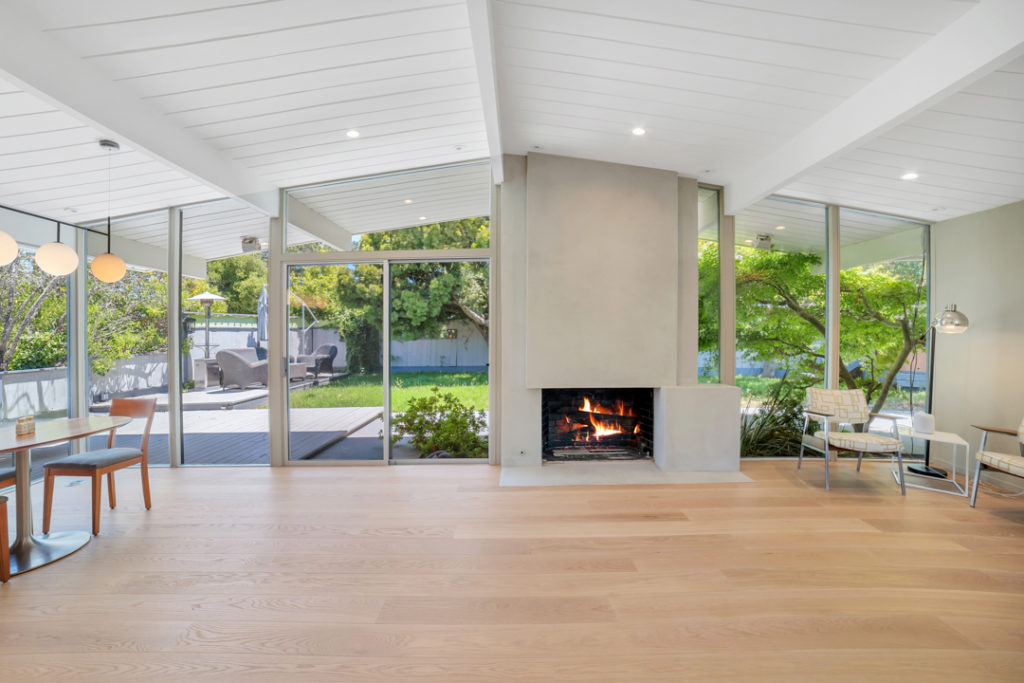 Modern living by the fire in this San Mateo Eichler remodeled by Keycon
