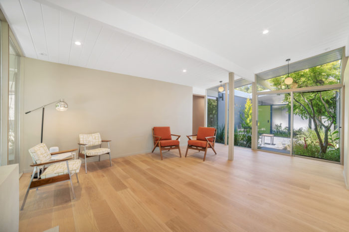 Outdoor views on both sides in this San Mateo Eichler remodeled by Keycon