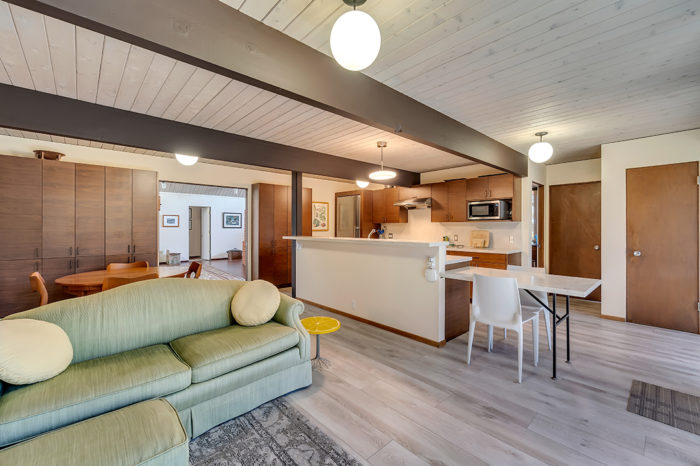 Beautiful beams bring living areas together in this Keycon Eichler remodel